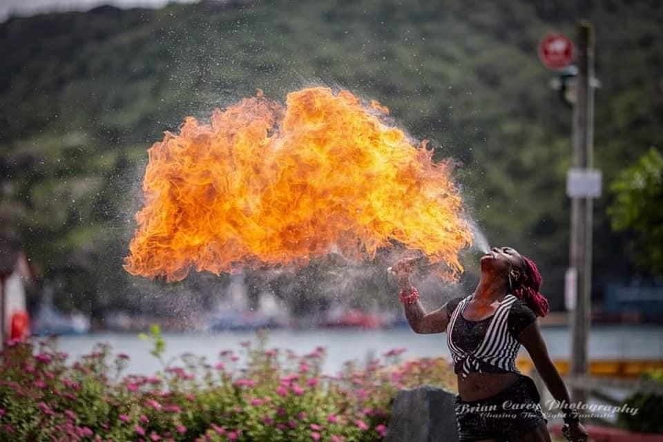 Martika Daniels breathing fire.